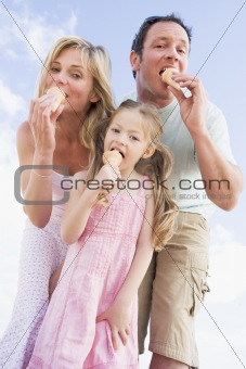 Family standing outdoors with ice cream