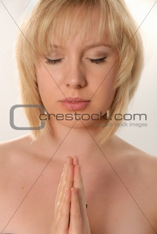 angelic young woman praying