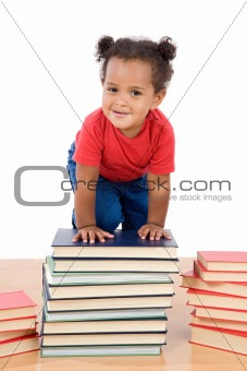 Baby climb up over a pile of books