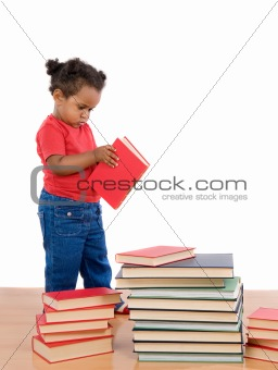 Adorable african baby reading