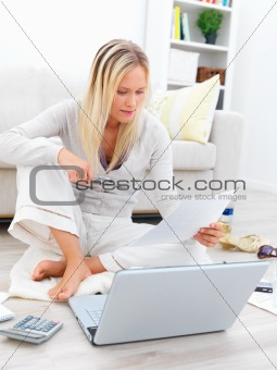 Young businesswoman looking at documents