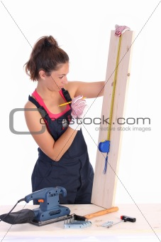 woman carpenter with wooden plank
