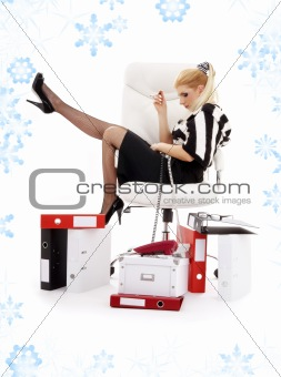 tired businesswoman in chair with snowflakes