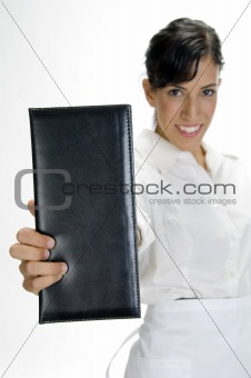 attractive waitress showing bill book