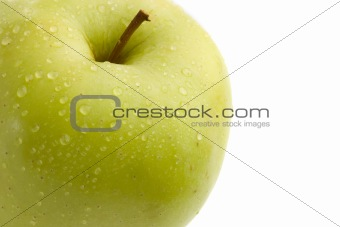 Green delicious apple with drops of water
