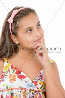 Adorable girl with flowered dress thinking
