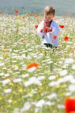 boy in traditional clothes in flowers