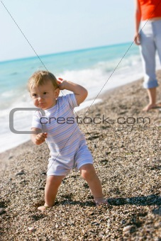 baby boy on beach