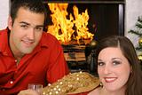 shot of a happy gorgeous couple in front of fireplace