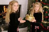 shot of twin children opening presents