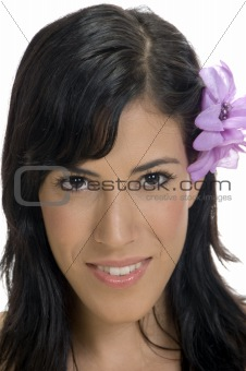 portrait of smiling woman with flower in her hair