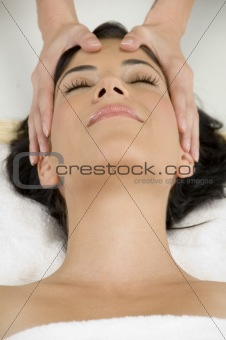 young pretty woman getting head massage