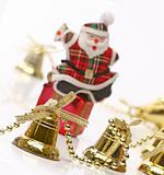 Santa over gift box with christmas bells