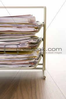 A Stack Of Paperwork Sitting In A Tray