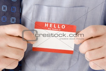 Close Up Of Businessman Attaching Name Tag