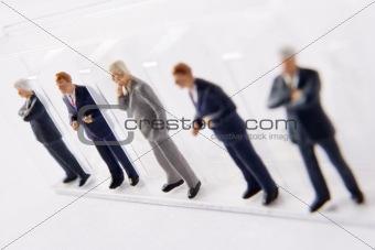 Line Of Businessmen Figurines