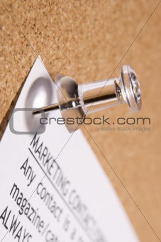 Close Up Of Thumbtack In Bulletin Board