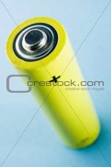 A Yellow Battery Against A Blue Background