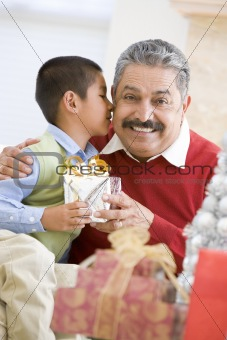 Boy Surprising Father With Christmas Present