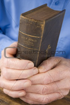 Older Man Holding Bible