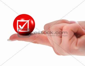 tick sign on finger shallow DOF