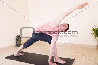 Attractive mature man doing yoga