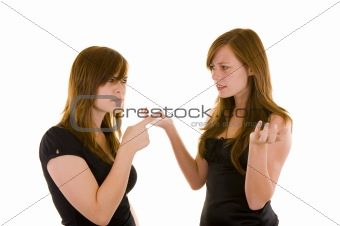 Beautiful young sisters arguing