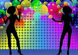 Silhouettes of dancing girls and disco light