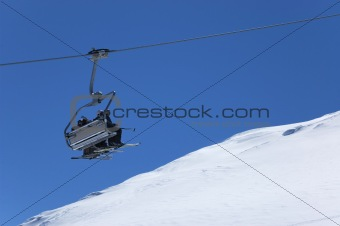 Chair lift at ski resort. Winter vacations