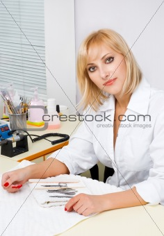 manicurist portrait in interior of nail salon