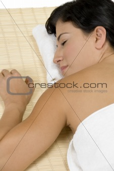 female sleeping on bamboo mat