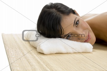 laying woman looking to camera