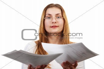 Young girl with sheets of paper in her hands