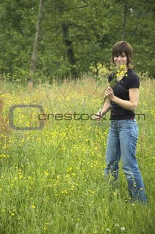 Beautiful girl picking flowers