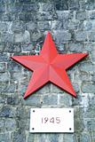 Monument with red star