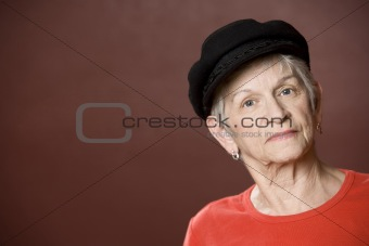 Senior woman in a Greek fishing hat