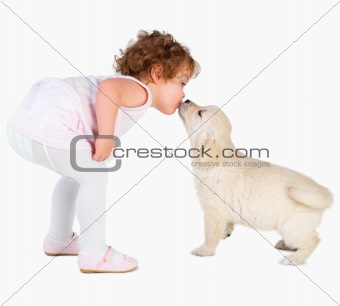 young child with cute labrador puppy
