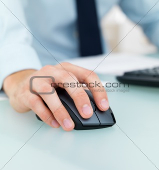 Closeup of a male&#39;s hand working on a computer mouse
