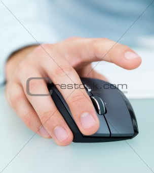 Closeup of a male's hand working on a computer mouse