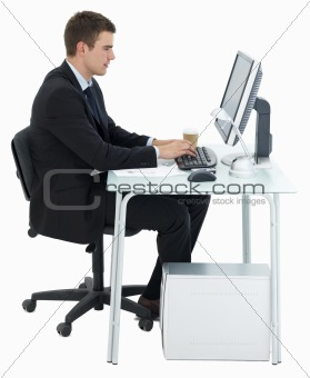 Business man working at office desk isolated on white