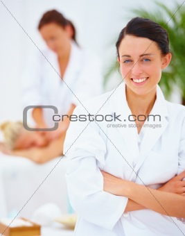 Young beautiful female therapist at spa