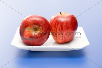 Apples in white plate