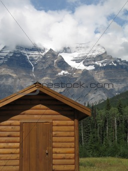 cottage at the foot of mountains