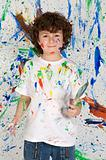 Little boy playing with painting