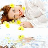 beauty with yellow flowers on white sand