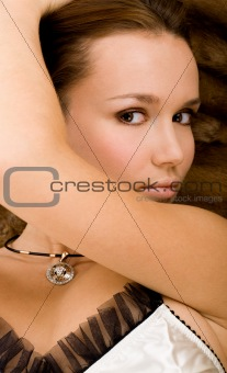 Attractive woman on fur background