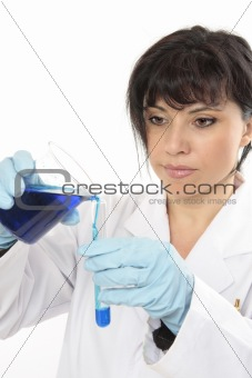 Chemist pours liquid into test tube