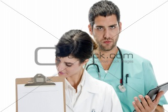 medical professionals with paper in writing board