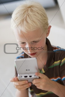 Boy playing on a game console