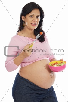 Beautiful pregnant eating salad